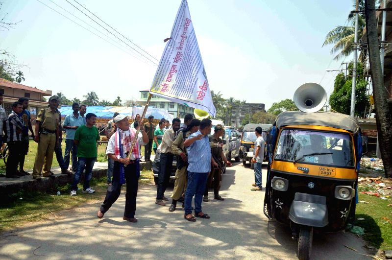Sansuma Khunggur Bwiswmuthiary independent candidate from Kokrajhar  flags-off an auto-rickshaw rally during an election campaign in Kokrajhar of Assam on April 20, 2014.
