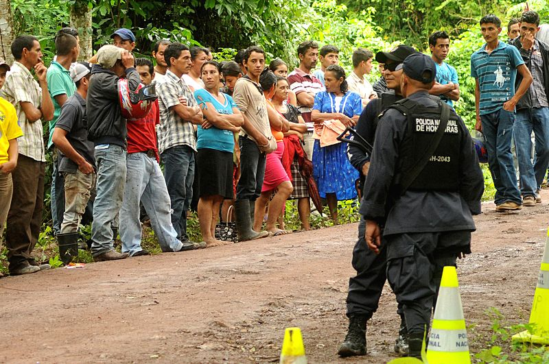 Santa Barbara: Honduran security officers stand guard at the place where the bodies of Miss Honduras, Maria Jose Alvarado and her sister Sofia Trinidad were found, near the city of Santa Barbara, in .