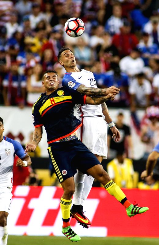 SANTA CLARA, June 4, 2016 - Colombia player Edwin Cardona (L) competes for a header with U.S. player Geoff Gameron during the opening match of Copa America Centenario between Colombia and the United ...