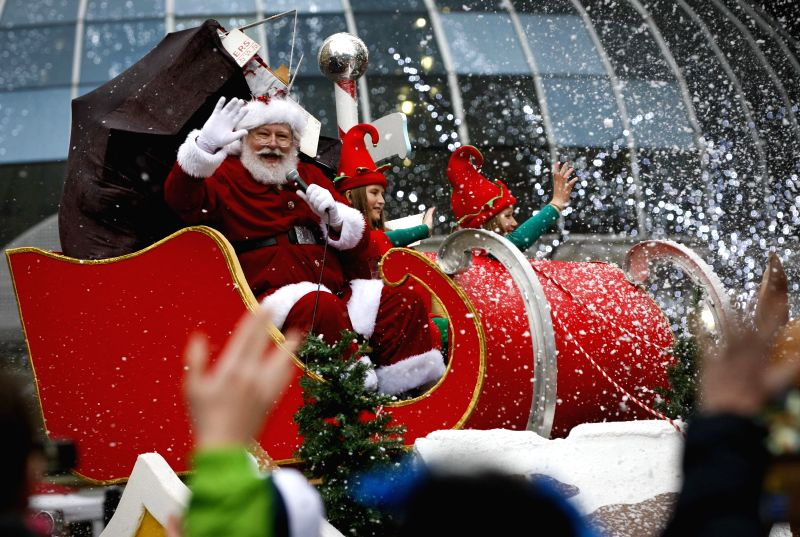 Santa Claus waves hands to the people during the 12th Santa Claus parade in Vancouver, Canada, Dec. 6, 2015. Over 3,500 participants from more than 50 groups ...