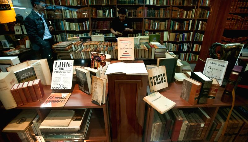 People visit a bookstore specialized in old books in the city of Santiago, capital of Chile, on April 23, 2014. The World Book Day is commemorated on Wednesday, ..