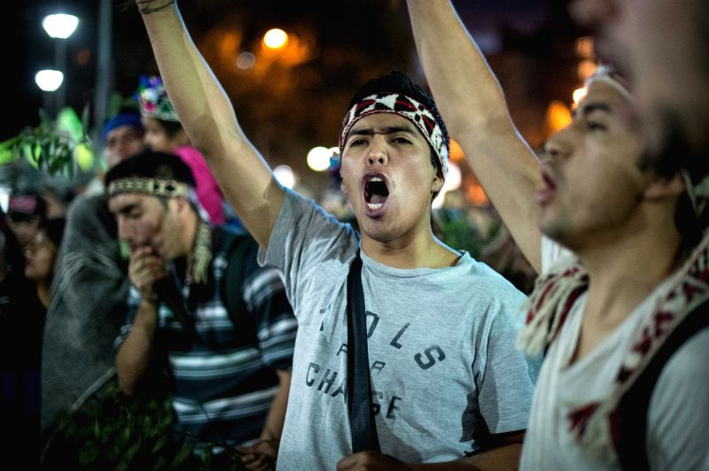 SANTIAGO, April 7, 2016 - People take part in a march in support of the Mapuche ethnic group in Santiago, capital of Chile, on April 6, 2016. According to local press, the march in support of Mapuche ...