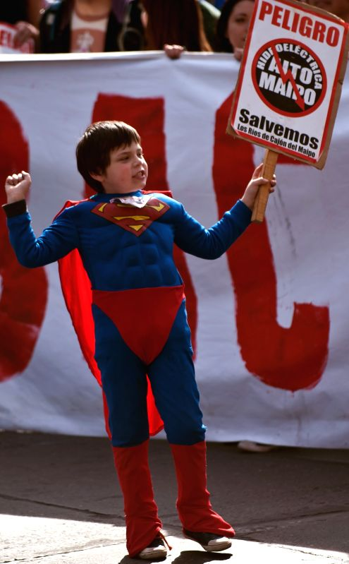 """A boy takes part in the march """"No Alto Maipo"""", called for by the Citizen Coordinator Rios del Mapio, in Santiago, Chile, on Aug. 2, 2014. The march was ..."""