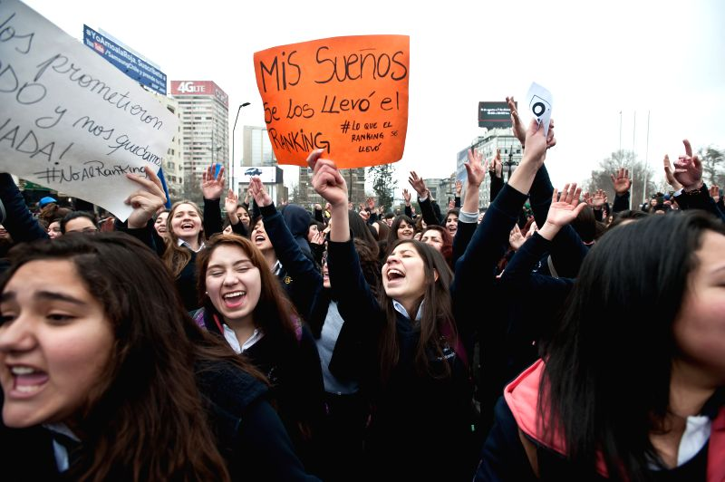 Students of educational emblematic establishments take part in a march in Santiago, capital of Chile, on Aug. 27, 2014. The march was aimed at expressing rejection