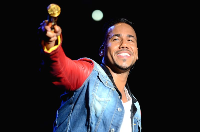 "Bachata singer Romeo Santos performs during his concert ""The King"" at Cibao Stadium in Santiago, Dominican Republic, on Dec. 14, 2014."