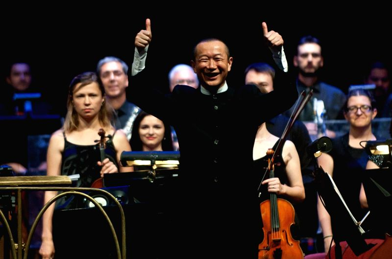 """Chinese composer Tan Dun gestures after directing the concert """"Trilogy of Martial Arts"""" at the 22nd International Festival """"Santiago a Mil"""" in .."""