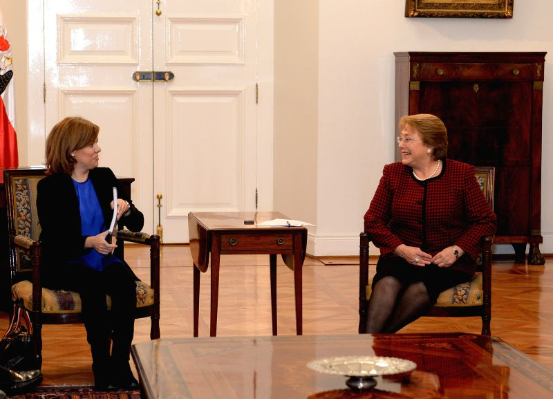 Image provided by the Chile's Presidency shows Chilean President Michelle Bachelet (R) meets with the Deputy Prime Minister of Spain, Soraya Saenz in the ...