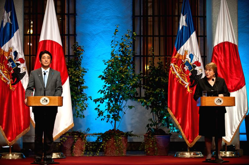 Chile's President Michelle Bachelet (R) and Japan's Prime Minister Shinzo Abe take part in a press conference, at La Moneda Palace, in Santiago, capital of Chile, .