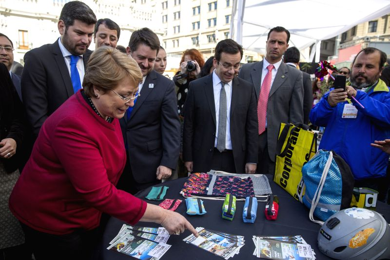 Chilean President Michelle Bachelet (L) participates in the inauguration of the Santiago Tourism Expo, in Santiago, capital of Chile, on June 18, 2015. ...