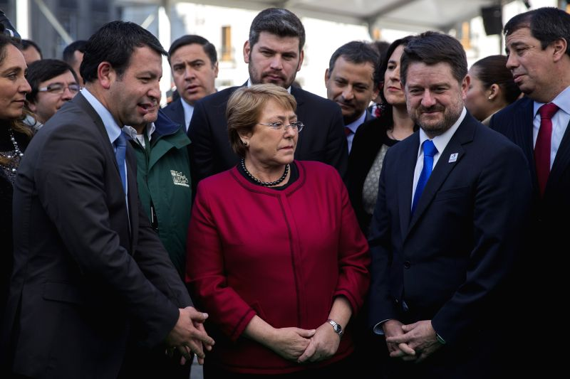 Chilean President Michelle Bachelet (C) participates in the inauguration of the Santiago Tourism Expo, in Santiago, capital of Chile, on June 18, 2015. ...
