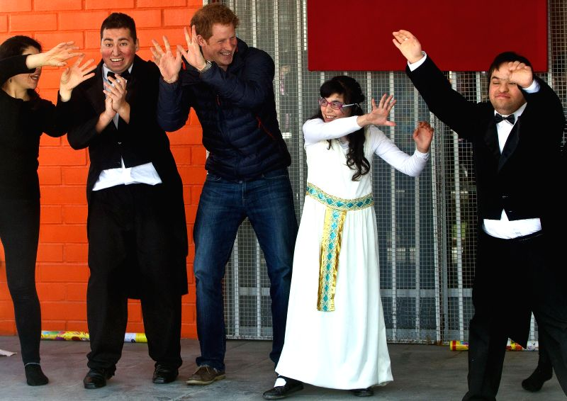 Prince Harry (C) of Britain dances during his visit to the Friends of Jesus Foundation, in Santiago, capital of Chile, on June 29, 2014. Prince Harry is on a ...