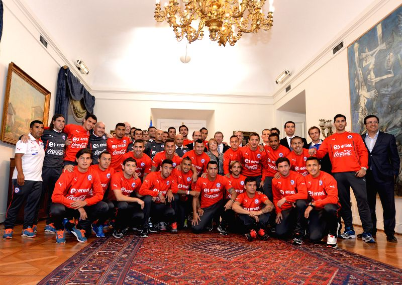 Image provided by Chile's Presidency shows Chilean President Michelle Bachelet (C) poses with Chile's National Team at Presidential Palace in the city of Santiago,