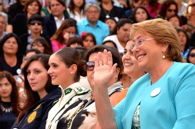 Image provided by Chile's Presidency shows Chilean President, Michelle Bachelet (R), participating in the commemoration of the International Women's Day, in the ...