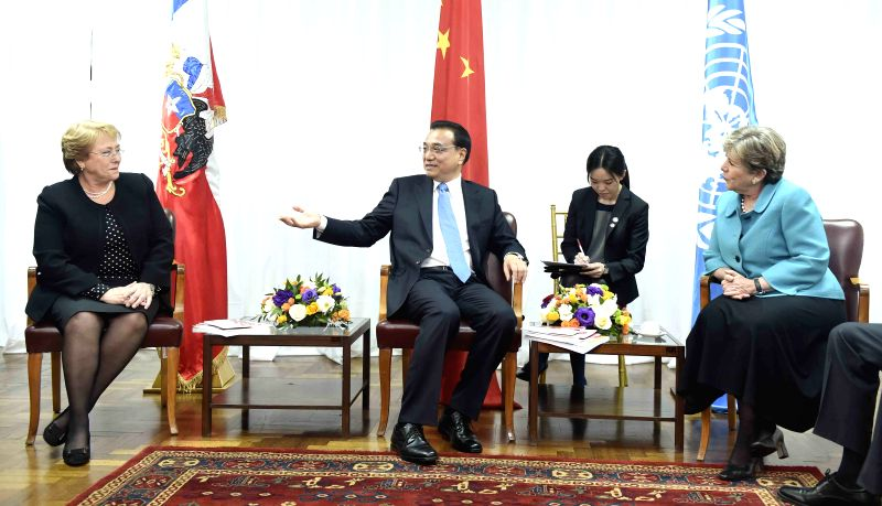 Chinese Premier Li Keqiang (C) meets with Alicia Barcena (R), executive secretary of the United Nations Economic Commission for Latin America and the Caribbean ...