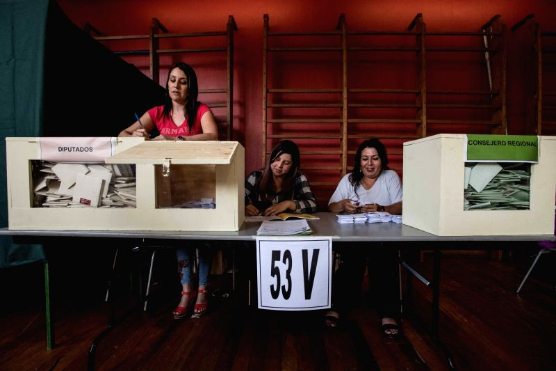 SANTIAGO, Nov. 19, 2017 - Staff members count ballots at a polling station in Santiago, capital of Chile, on Nov. 19, 2017. Former Chilean President Sebastian Pinera is leading the presidential ...