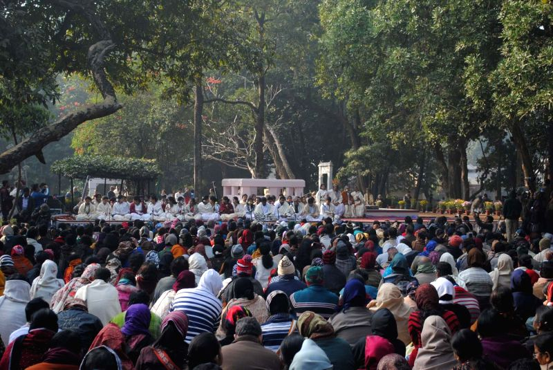 People gather as artists perform during Poush Mela - an annual fair in Santiniketan, West Bengal on Dec.23, 2014. Poush Mela was started by Devendranath Tagore on 21 December 1891.