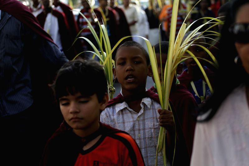 Children take part in a procession at the colonial zone, during the celebrations of Sunday Palm in the city of Santo Domingo, capital of Dominican Republic, .