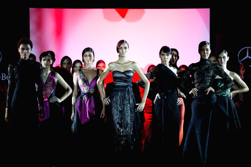 """Models present creations of Hanibal Laguna's """"Lights of Spain"""" collection during the 1st edition of Mercedes-Benz Fashion Week Santo Domingo, in ..."""