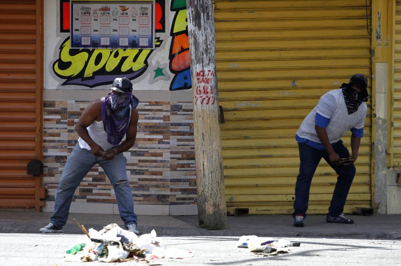Residents participate a protest in the Capotillo neighborhood, in Santo Domingo, Dominican Republic, on Aug. 27, 2014. The residents protested demanding the ..