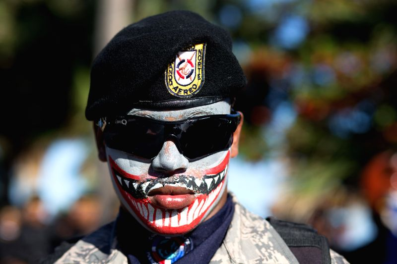 A soldier of the National Army takes part in a traditional military parade, in commemoration of the 171th anniversary of the National Independence Day, in ...