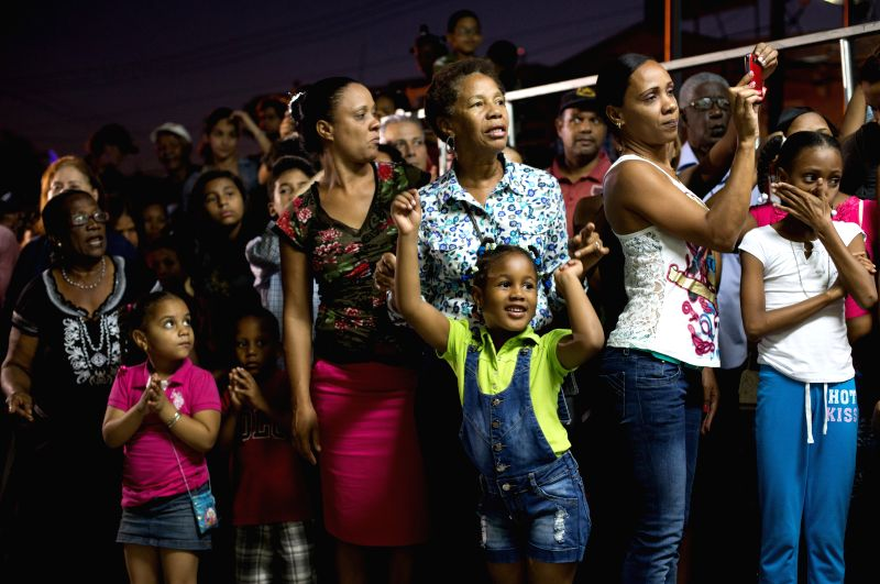 People react during the Three Wise Men parade on the eve of Wise Men Day, in Santo Domingo, Dominican Republic, on Jan. 5, 2015. The Firemen Core of National ..