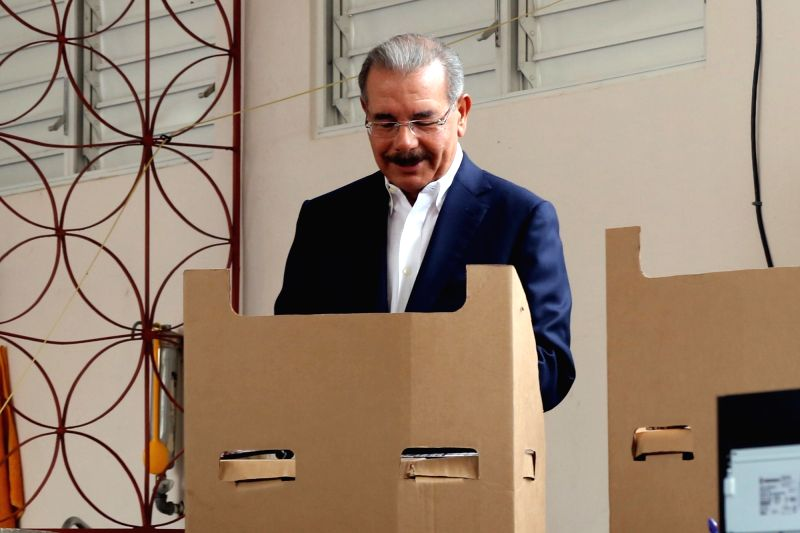 SANTO DOMINGO, May 15, 2016 - Danilo Medina, president of Dominican Republic and candidate for the election, fills in his ballot prior to casting vote in a polling station during the general ...