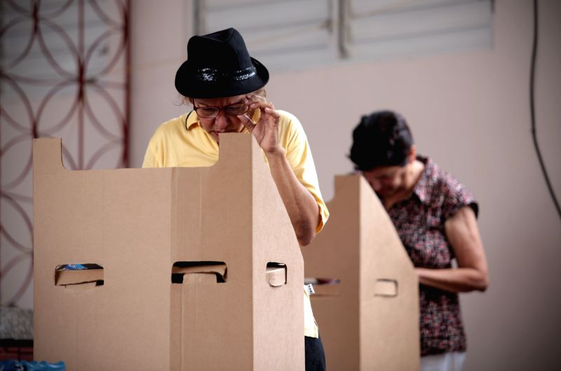 SANTO DOMINGO, May 16, 2016 - People cast ballot during the presidential election at a polling station in Santo Domingo May 15, 2016. The Dominican Republic held presidential election on Sunday.