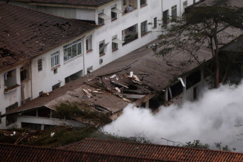 Smoke rises from the crash site of the aircraft carrying the presidential candidate for the Socialist Party of Brazil Eduardo Campos in a residential zone of the ...