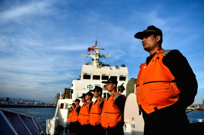 SANYA, April 17, 2017 - Crew members stand onboard a police vessel in Sanya, south China's Hainan Province, April 17, 2017. Two Chinese maritime police vessels on Monday left Sanya for a ...