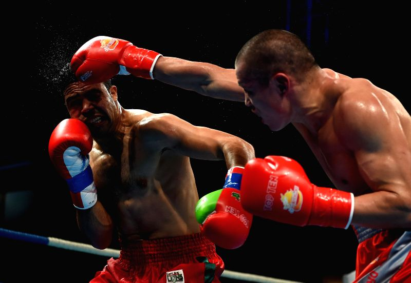 Zhou Di (R) of China fights against Harnouf Said of Morocco during their men's 75kg match at the World Series of Boxing (WSB),  in Sanya, south China's Hainan ...