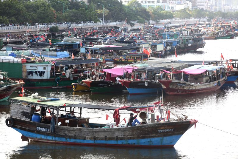 Fishing boats are anchored at a port in Sanya, south China's Hainan Province, May 16, 2014. A routine two-and-a half month fishing ban started at noon Wednesday in the