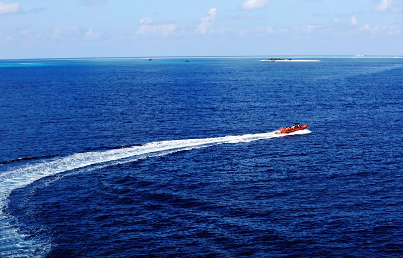 Tourists take speedboat to Yinyu Island of Xisha Islands, south China's Hainan Province, Sept. 3, 2014. A cruise route, linking the city of Sanya in the Hainan ...