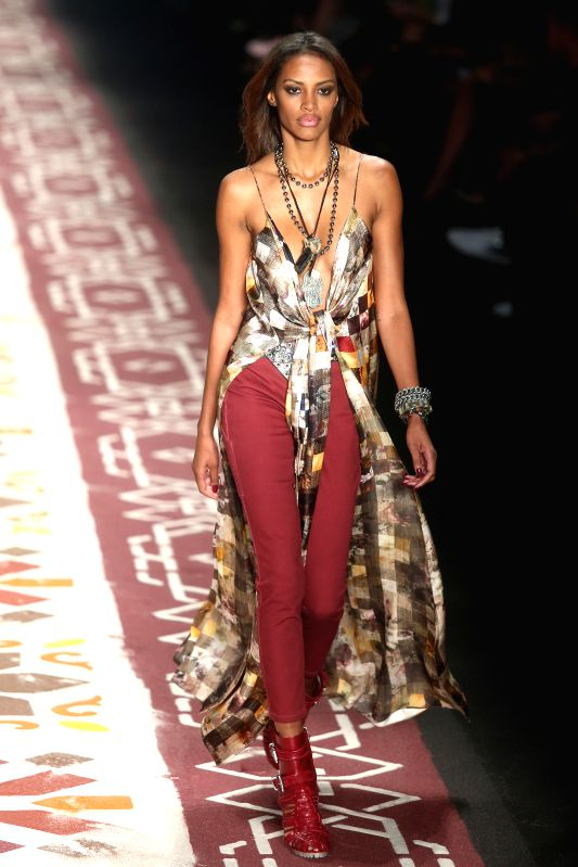 """A model presents a creation of the Summer Collection of """"Ellus"""", during the Sao Paulo's Fashion Week, in Sao Paulo, Brazil, on April 14, 2015. ..."""