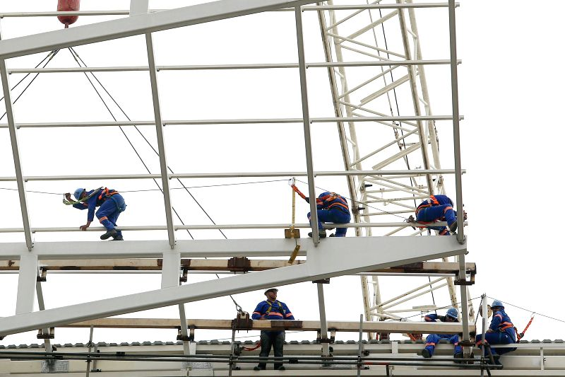 Employees work at the Corinthians Arena in Sao Paulo, Brazil, on April 22, 2014. The Corinthians Arena will host the opening match of the World Cup 2014 between .