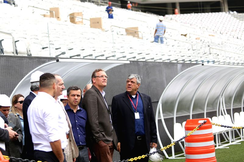 Jerome Valcke (2nd R), General Secretary of the International Federation of Association Football (FIFA) visits the Corinthians Arena in Sao Paulo, Brazil, on ...