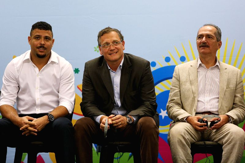Jerome Valcke(C), General Secretary of the International Federation of Association Football (FIFA), Brazil's Sports Minister Aldo Rebelo(R) and former Brazilian . - Aldo Rebelo