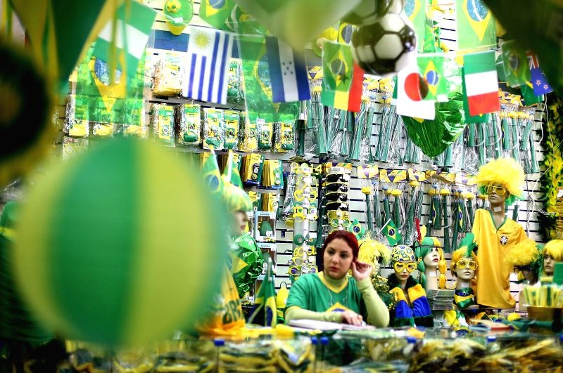 Decorations and accessories with the colors of Brazil's National flag, are shown for sale in a popular street market, in downtown Sao Paulo, Brazil, on April 28,