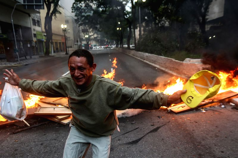 SAO PAULO, April 29, 2017 - A man reacts in front of a fire barricade during a nationwide general strike in Sao Paulo, Brazil, on April 28, 2017. Brazil's transportation, schools and businesses were ...
