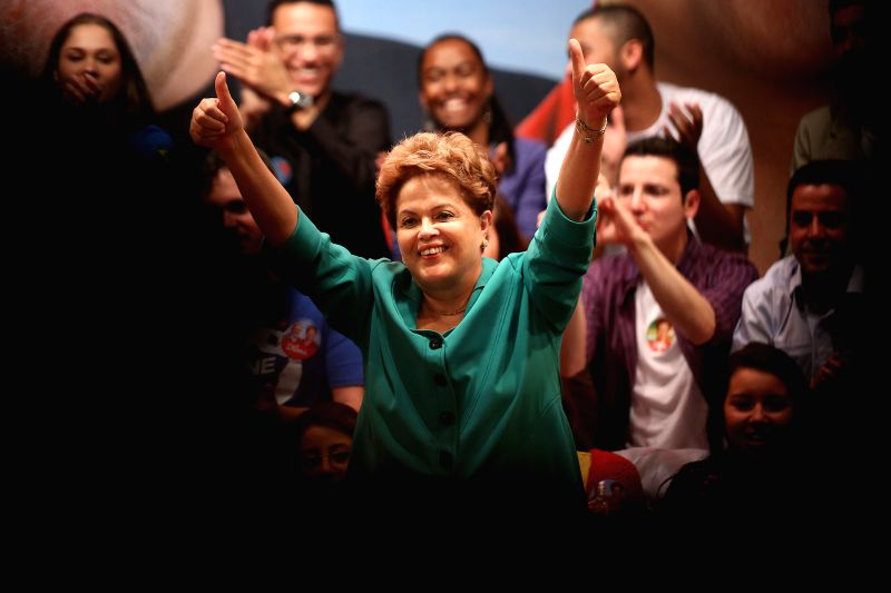 Brazil's President and Presidential Candidate, Dilma Rousseff (C), reacts during an electoral campaign event, in Sao Paulo, Brazil, on Aug. 11, 2014. The ...