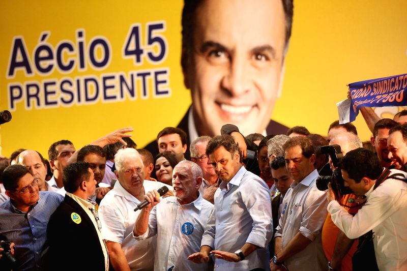 The presidential candidate Aecio Neves (front 5th L) of the Brazilian Social Democratic Party (PSDB, for its acronym in Portuguese), takes part in a campaign ...