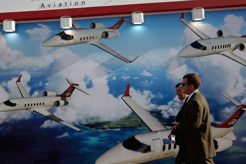 Visitors attend the annual meeting of the 11th Latin-American Business Aviation Conference and Exhibition (LABACE) 2014, in the Congohas Airport in Sao Paulo, ..