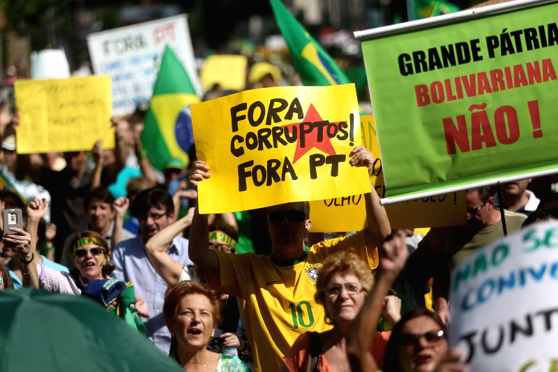 Sao Paulo (Brazil): Brazilian people take part in a protest against Brazil's President Dilma Rousseff, at Paulista Avenue in Sao Paulo, Brazil, on Dec. 6, 2014.