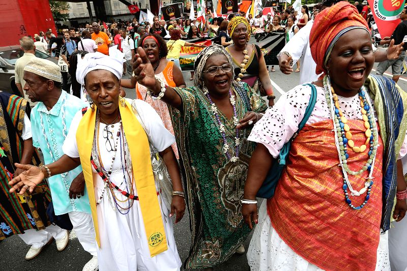 Sao Paulo (Brazil): People take part in the celebration of Black Consciousness Day in Sao Paulo, Brazil, on Nov. 20, 2014. The Day of Black Consciousness was first celebrated in 1978 to commemorate ..