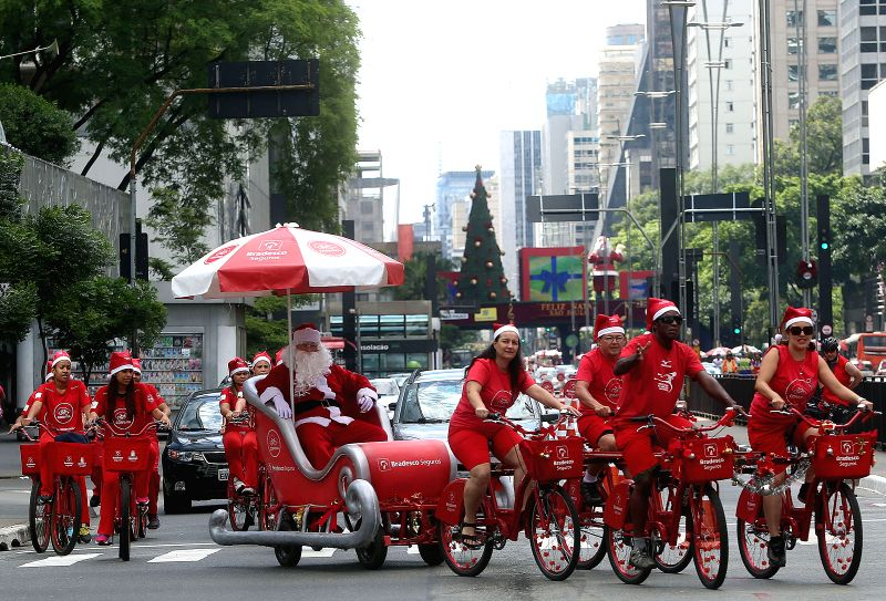 A person disguised as Santa Claus rides a sleigh pulled by bicycles in Sao Paulo, Brazil, on Dec. 14, 2014.