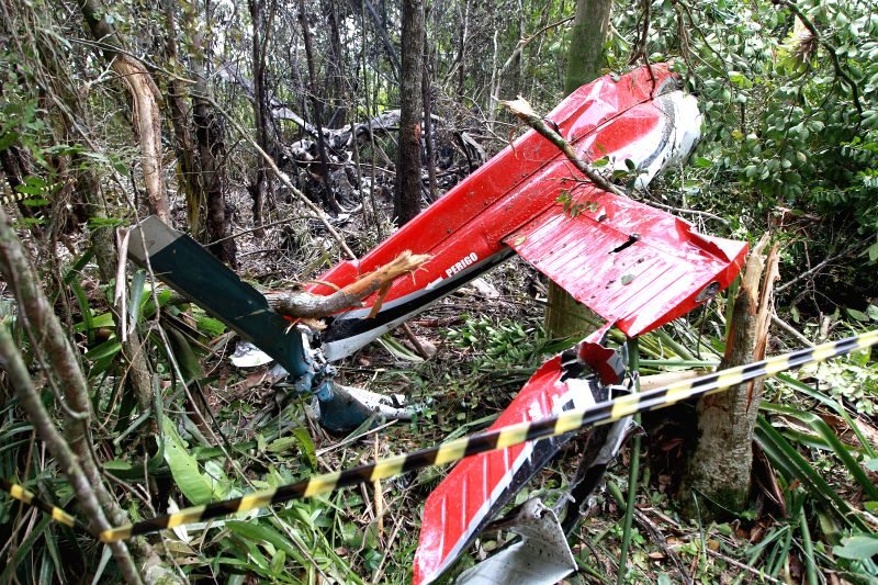 The wreckage of a helicopter is seen at its crash site at the kilometer 229 of the Rio-Santos highway, region of Bertioga, Sao Paulo, Brazil, on Dec. 27, 2014. ...