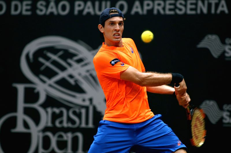 Brazil's Guilherme Clezar returns the ball to Spain's Albert Ramos Vinolas during the ATP Brazil Open tennis tournament in Sao Paulo, Brazil, Feb. 9, 2015. ...