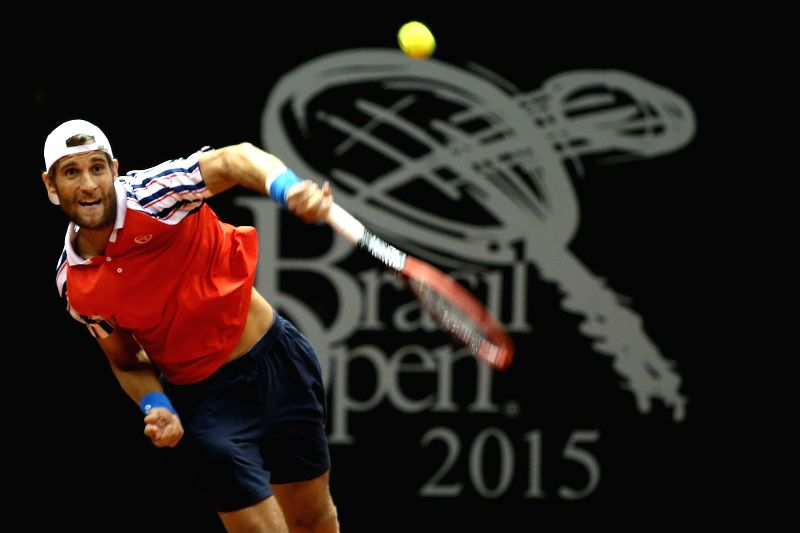 Slovakia's Martin Klizan returns the ball to Brazil's Thomas Bellucci during a match at the 2015 ATP Brazil Open in Sao Paulo, Brazil, on Feb. 10, 2015. ...
