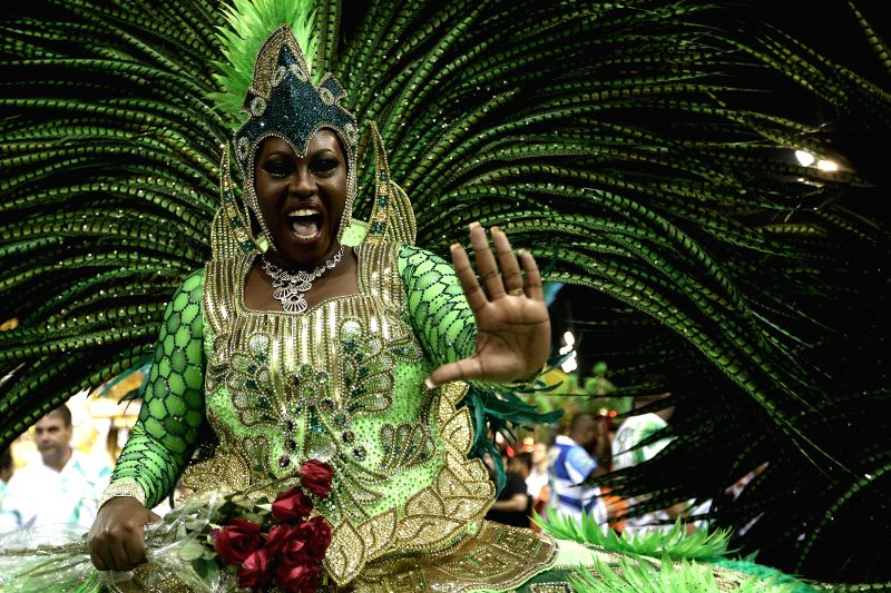 "A dancer of ""Mancha Verde"" takes part in the first night of the parade of samba schools of the Carnival, in the Anhembi Sambadrome, in Sao Paulo, ..."