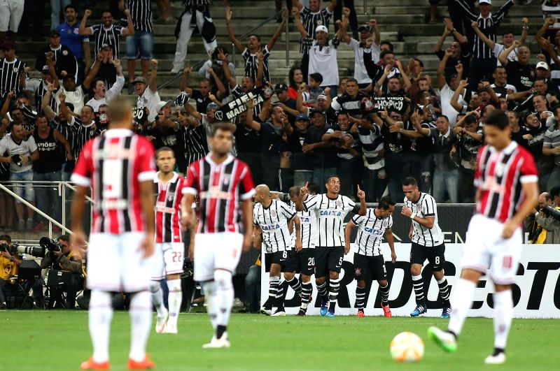 SAO PAULO, Feb. 19 Corinthians's players celebrate a scoring during the match of Copa Libertadores against Sao Paulo at the Arena Corinthians Stadium in the city of Sao Paulo, Brazil, on ...