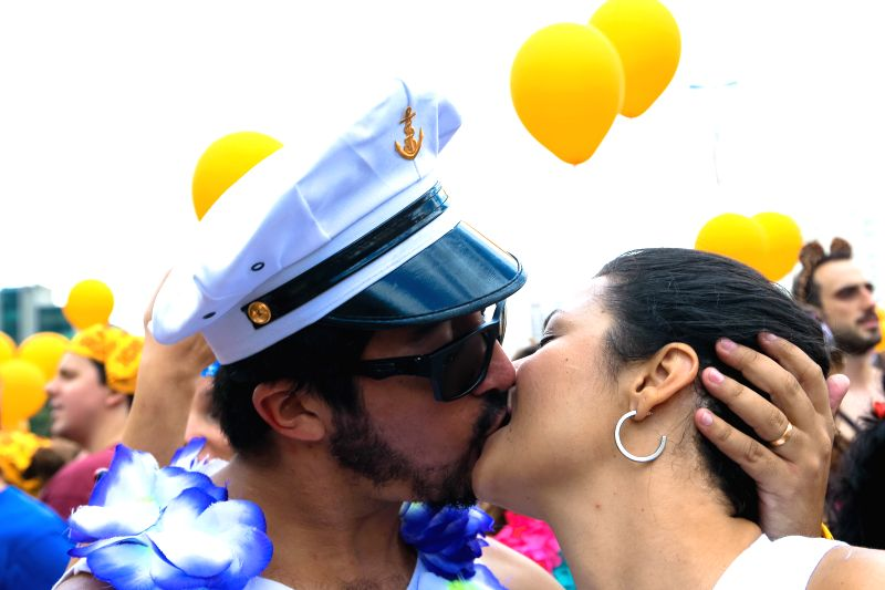 "A couple kisses as they attend the street parade ""Bangalafumega"", part of the pre-Carnival festivities at Sumare neighborhood in Sao Paulo, Brazil, on ..."